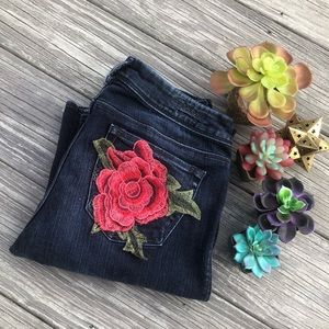 Women's dark wash Silver jeans w roses size 28